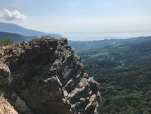 High cliff under the forest of Crimea royalty free stock photo