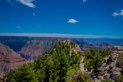 High cliffs above Bright Angel canyon, major tributary of the Grand Canyon, Arizona, view from the north rim. In USA stock images