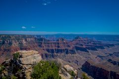High cliffs above Bright Angel canyon, major tributary of the Grand Canyon, Arizona, view from the north rim. In USA stock photography