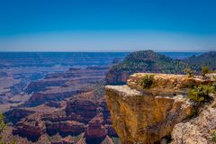 High cliffs above Bright Angel canyon, major tributary of the Grand Canyon, Arizona, view from the north rim. In USA royalty free stock image