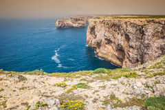 High cliffs and blue ocean at Cabo Sao Vicente on coast of Portu Stock Photography