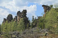 High cliffs among trees royalty free stock photos