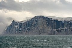 HIgh Cliffs Under Dramatic Clouds Royalty Free Stock Photos
