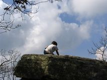 High climber ( boy on a rock) Royalty Free Stock Photo