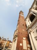 High clock tower of the Palladian Basilica in italian city Royalty Free Stock Images