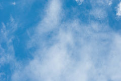 High Cloud. Fluffy white clouds in blue sky. Clouds floating on the top of the Earth`s atmosphere Stock Photos