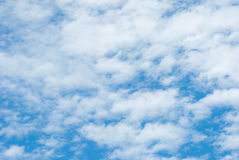 High Cloud. Fluffy white clouds in blue sky. Clouds floating on the top of the Earth`s atmosphere Royalty Free Stock Photography