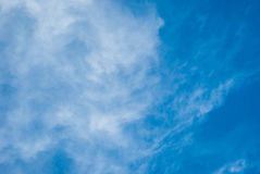 High Cloud. Fluffy white clouds in blue sky. Clouds floating on the top of the Earth`s atmosphere Stock Image