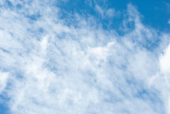 High Cloud. Fluffy white clouds in blue sky. Clouds floating on the top of the Earth`s atmosphere Stock Images