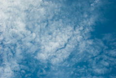 High Cloud. Fluffy white clouds in blue sky. Clouds floating on the top of the Earth`s atmosphere Royalty Free Stock Image
