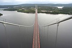 High Coast Bridge. The High Coast Bridge (swedish: Högakustenbron) is a suspension Bridge,  crossing Ångermanälven river in Sweden Stock Image