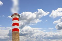 High concrete chimney emits CO2 into the atmosphere - concept image.  stock images