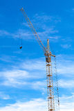 High construction crane on blue sky background Royalty Free Stock Images