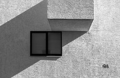 High contrast abstract architecture. High contrast black and white picture of modern abstract looking building with window and balcony detail royalty free stock images