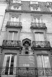 Victorian Style French Apartment with Patron Saint. A high contrast black and white image of a beautiful typical french apartment with window balcony and a small Stock Photo