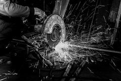 High contrast in black and white Worker use Electric grinder cut Stock Photo