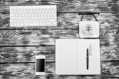 High contrast black and white working place. View from above: keyboard, coffee, mobile phone Royalty Free Stock Images