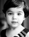 High contrast bw portrait. Of a baby girl with sharp eyes stock photo