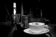 High contrast Coffee cup and measuring cup and coffee set. In black and white Royalty Free Stock Photography