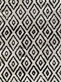 High contrast diamond pattern black and white throw rug. Modern farm house interior design and decor. Boho chic design royalty free stock photography