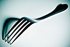 High contrast fork. High contrast close-up of a fork with defined shadows royalty free stock photography