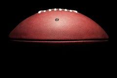 High Contrast Horizontal American Football. Horizontal American Style Football in high contrast on black Royalty Free Stock Photo