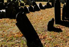 High contrast image of American War of Independence graves seen in a famous Boston cemetery. Very old, mainly slate, gravestones for soldiers and casualties for Royalty Free Stock Photo