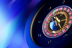 Casino theme. Place for typography. High contrast image of casino roulette. Blue background. Place for text stock photography