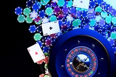 Casino concept. Place for text. High contrast image of casino roulette, poker chips, cards, dice. Place for text or typography royalty free stock image