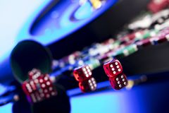 Casino concept. Place for text. High contrast image of casino roulette, poker chips, dice. Place for text or typography royalty free stock photos