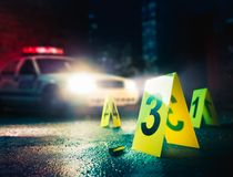 High contrast image of a crime scene. Police car at a crime scene with evidence markers, high contrast image stock photos