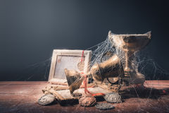 High contrast image of dusty trophies with cobwebs representing. Broken or abandoned dreams royalty free stock image