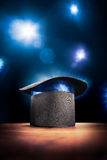 High contrast image of magician hat on a stage Stock Photos
