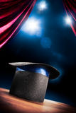 High contrast image of magician hat on a stage Stock Image