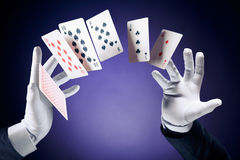 High contrast image of magician making card tricks Royalty Free Stock Image
