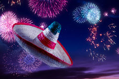 High contrast image of Mexican hat / sombrero in the sky with fireworks royalty free stock photos