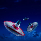 High contrast image of Mexican hats / sombreros in the sky at ni Royalty Free Stock Images