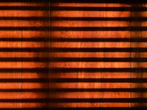High contrast light and shadow on brown wood floor. High contrast light and shadow strips on old vintage brown wood floor royalty free stock photo