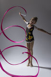 High Contrast Portrait of Caucasian Female Rhythmic Gymnast. Sport Concepts. High Contrast Portrait of Caucasian Female Rhythmic Gymnast In Professional Royalty Free Stock Photos