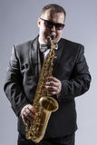 High Contrast Portrait of Caucasian Mature Expressive Saxophone Player Royalty Free Stock Photos