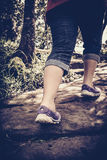 High contrast vintage tone of woman walking exercise, health con. High contrast vintage portrait of tourist`s feet on pathway in the forest. Woman walking Stock Image