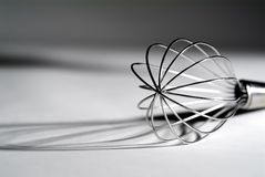 High contrast whisk. High contrast view of a standard wisk revealing interesting shadows stock photography