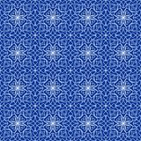 High contrasting seamless background tile with filigree white ornament on blue canvas. Vintage fabric style in damask design. Royalty Free Stock Photography