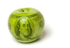 High cost of education apple. Green apple with a $100 bill superimposed over it to symbolize the cost of education Royalty Free Stock Photos