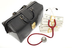High cost of healthcare. A doctor's bag next to bundles of cash and a stethoscope Royalty Free Stock Photos