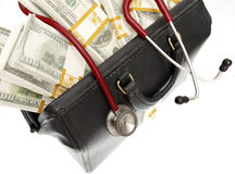 High cost of healthcare. A doctor's bag filled with bundles of cash Royalty Free Stock Images