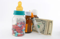 High cost of medical bills for children. High costs of children medication, bottle & pills, tall perspective and apparent tall bottle emphasizes high cost Stock Image