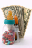 High cost of medical bills for babies. Health concept of high cost of medical bills for babies with syringe, bottle and money Stock Photography