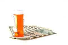 High Cost of Prescriptions. Isolated Money with a Prescription Bottle stock photography