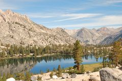 High country Arrowhead Lake in early sunlight. Arrowhead Lake is a high altitude lake above 10,000 feet in Kings Canyon National Park in California that is on Royalty Free Stock Photos